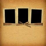 Tappningalbum med pappersramar för foto royaltyfria foton