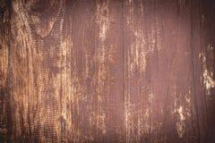 Tappningbakgrund av röd målarfärg på gammal wood textur Arkivbilder