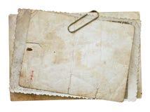 Tappningbakgrund med gamla papper, bokstäver och foto som isoleras på vit Royaltyfri Foto