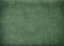 Tappningbakgrund som göras av olivgrön bomull arkivfoton