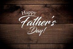 Tappningbaseballkugghjul på en träbakgrund med hälsning för dag för fader` s arkivfoton