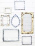 Tappningbildramar på den vita tegelstenväggen Fotografering för Bildbyråer
