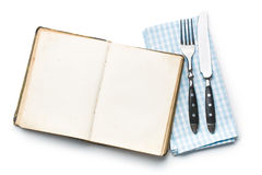 Tappningbok och bestick Fotografering för Bildbyråer
