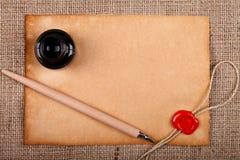Tappningbokstav med bläckhornen Arkivfoton