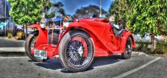 TappningengelskaMG motorisk bil Arkivfoto