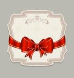 Tappningetikett med en röd bow för designemballage Arkivfoto