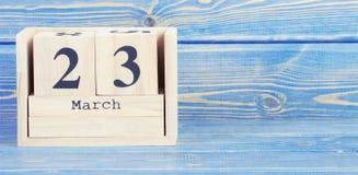 Tappningfoto, mars 23. Datum av 23 mars på träkubkalender Royaltyfri Bild