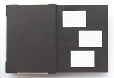 Tappningfotoalbum med den tomma sidan, vit fotoram arkivbilder