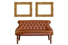 Tappningfotoet inramar och lyxigt sofamöblemang Arkivfoton