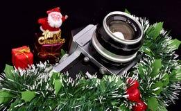 Tappningfotokamera och glad jul royaltyfria bilder