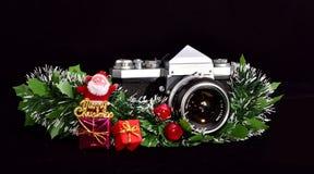 Tappningfotokamera och glad jul royaltyfri foto