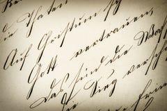 Tappninghandskrift antikt manuskript åldrigt papper royaltyfri foto