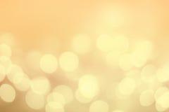 Tappningjulbakgrund med bokehljus Guld- Defocused Royaltyfria Bilder