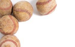 Tappningläderbaseball på en vit bakgrund Fotografering för Bildbyråer