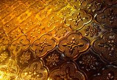 Tappningmålat glass för bakgrund, abstrakt guld- bakgrund Arkivbild
