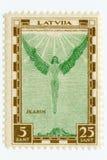 TappningmintkaramellLettland flygpost stämpel Icarus 1932 Royaltyfri Foto