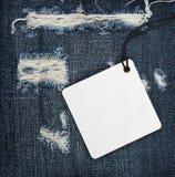 Tappningpappersetikett på blå grov bomullstvill Arkivbilder