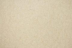 Tappningpapperstextur, att visa en detalj av brunt papper Royaltyfri Bild