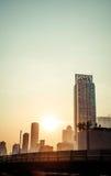 TappningsolnedgångBangkok cityscape, Thailand Arkivfoto