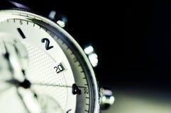 Tappningstil av lyxiga män klocka, begrepp av numret i klocka Arkivbild