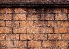 Tappningtegelstenvägg Royaltyfri Foto