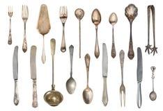 Tappningteskedar, gafflar, sockertång, kakaspatel, knivar som isoleras på vit bakgrund antik silverware royaltyfria foton