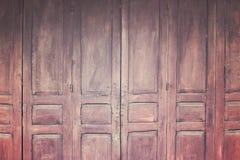 Tappningträhopfällbar dörr, retro stilbild Royaltyfri Bild