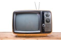 TappningTV på den wood tabellen Royaltyfria Foton