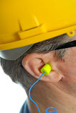 Tappo per le orecchie nell'orecchio Fotografia Stock Libera da Diritti