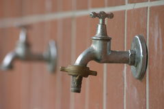 Taps. Two old taps at a wall royalty free stock photos