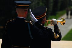 Taps, Arlington National Cemetery. A bugler plays Taps during a solemn wreath laying memorial service at Arlington National Cemetery Royalty Free Stock Image