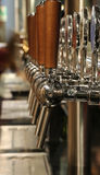 Taps for draft beer in the pub Stock Photography