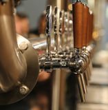 taps for draft beer in the pub royalty free stock photo