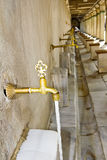 Taps outside Mosque for ritual purification Stock Photo
