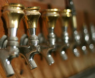 Taps. Row of dusty old beer taps in an abandoned bar Royalty Free Stock Images