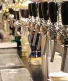 Taps to spill beer in the London pub. Lots of taps to spill beer in the London pub Royalty Free Stock Image
