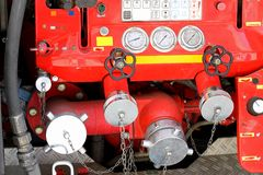 Taps and valves of trucks of firefighters with measuring gauges Royalty Free Stock Images