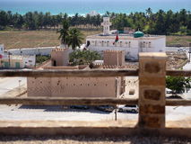 Taqah - castle and city. Taqah - a coastal town in Dhofar with a castle from 19th century Royalty Free Stock Photos