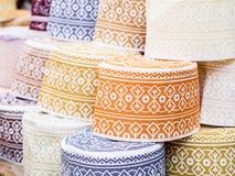 Taqiyah. Muslim hats called taqiyah on a stand in Darajani Market in Stone Town on Zanzibar Stock Photography