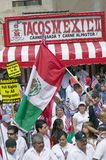 Taqueria stands in view as hundreds of thousands of immigrants participate in march for Immigrants and Mexicans protesting against Royalty Free Stock Photo