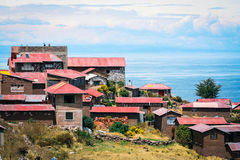 Taquile island houses and Titicaca lake Stock Images