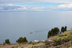 Taquile Island, lake Titicaca at background with boat. Peru. View from Taquile Island overlooking the water. Lake Titicaca. Peru Royalty Free Stock Photos