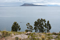 Taquile Island, lake Titicaca at background with boat. Peru. View from Taquile Island overlooking the water. Lake Titicaca. Peru Royalty Free Stock Image
