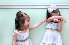 Taquinerie d'enfance Photos stock