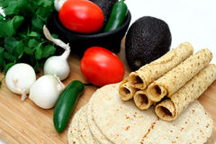 Taquitos And Vegetables Stock Photos