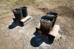 Tar or pitch buckets. Heating on a construction site Royalty Free Stock Photo