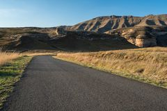 Tar road headed into the mountains. In Africa Royalty Free Stock Photography