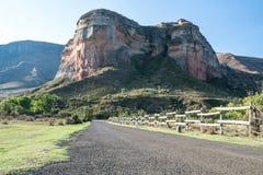 Tar road headed towards a mountain. Open tar road headed towards the face of a mountain Stock Photos