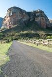 Tar road headed towards a mountain portrait. Tar road headed towards a mountain face portrait Stock Photo