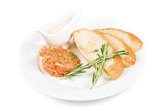 Tar-tar. From salmon fish with green onion. Served with honey sauce and white bread toast stock photography
